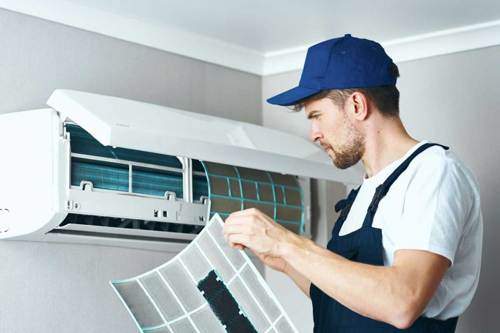 Man repair and cleaning air conditioner, worker at home