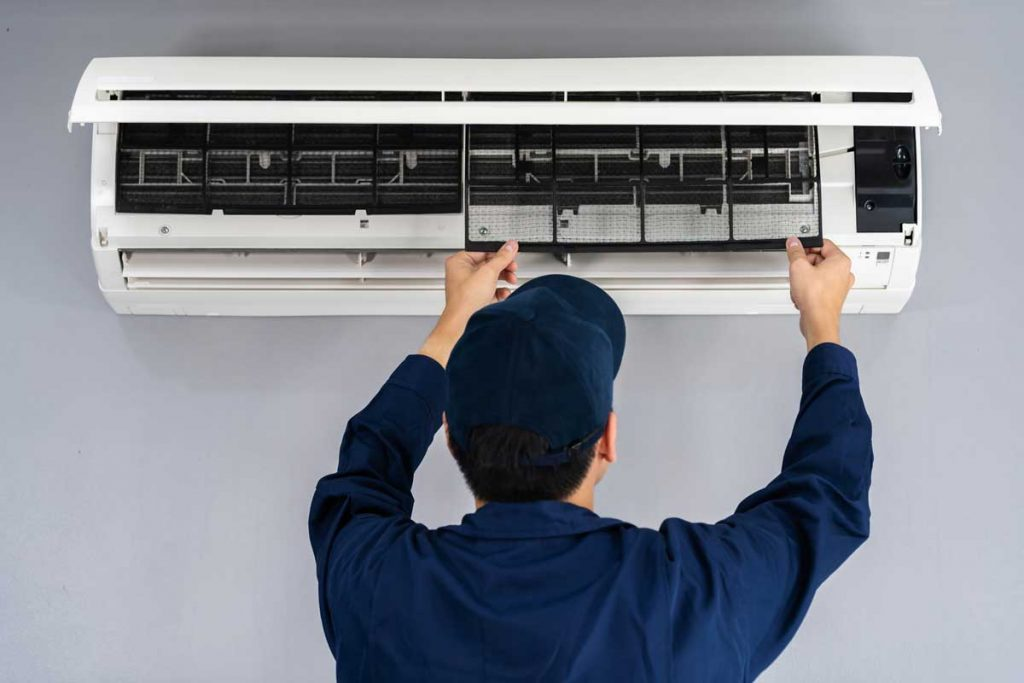 technician service removing air filter of air conditioner for cl